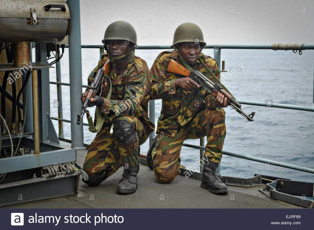 a-togolese-naval-boarding-team-provides-security-a-simulated-drug-EJRF69.jpg